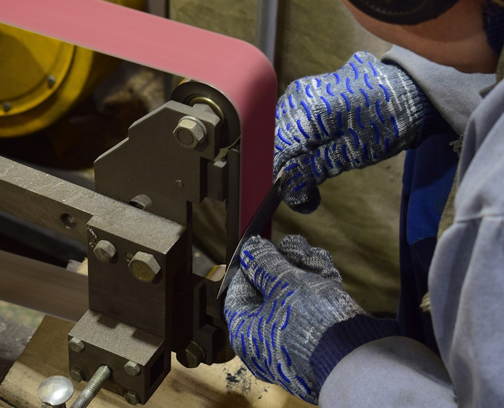 Making Cutting Edge. The blade is treated with abrasive tape. This is a very responsible and harmful process. The reason for that is much steel dust. The dust is separated from the blade and fills the air with tiny particles.