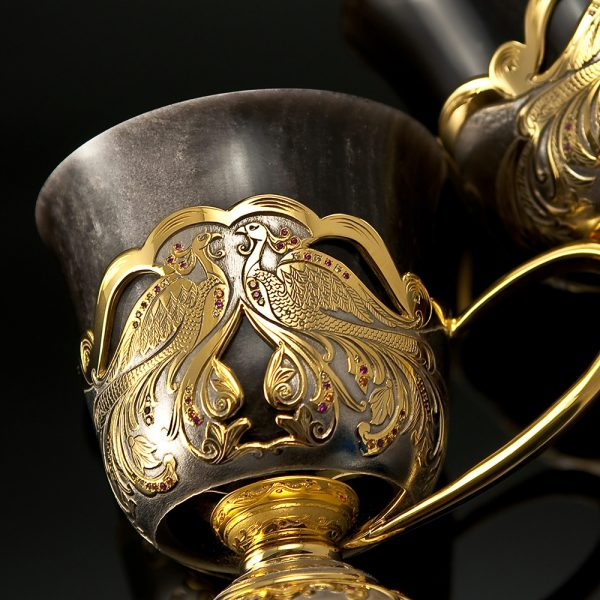 Luxury coffee mug carved in stone and decorated with gold and stones
