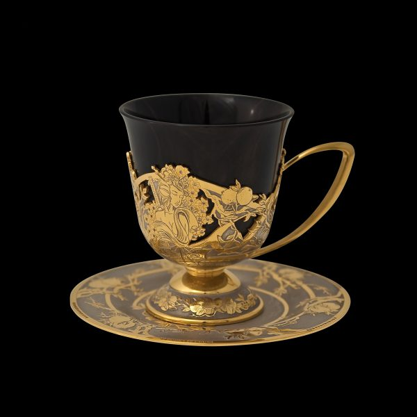 Handmade coffee cup, inlaid with stones, carved pattern and covered with gold