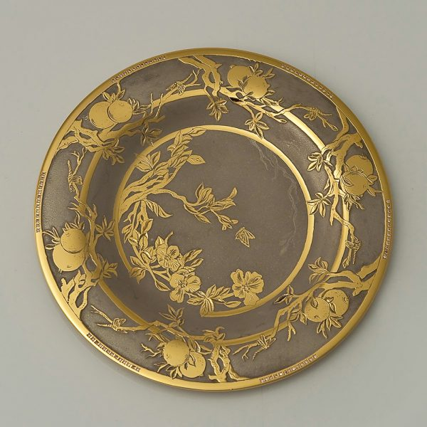 Small dish decorated with engraving and gold
