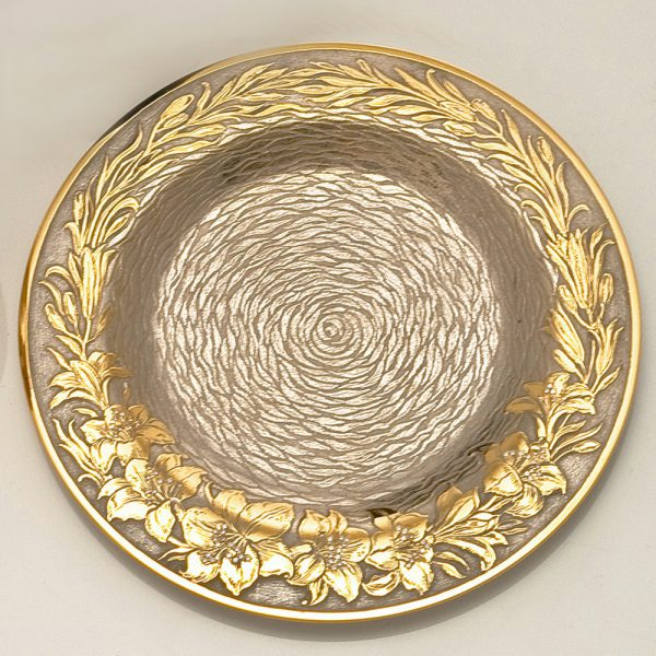 A small dish with amazing gold engraving
