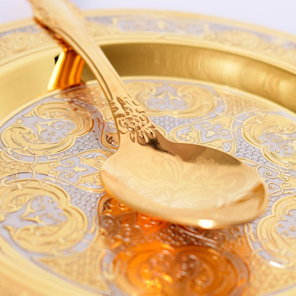 Golden spoon on the saucer art
