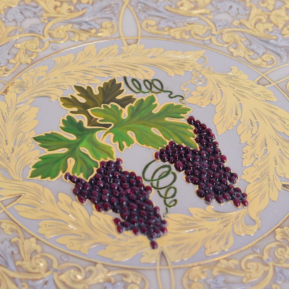 Artistic drawing of grapes on a golden dish