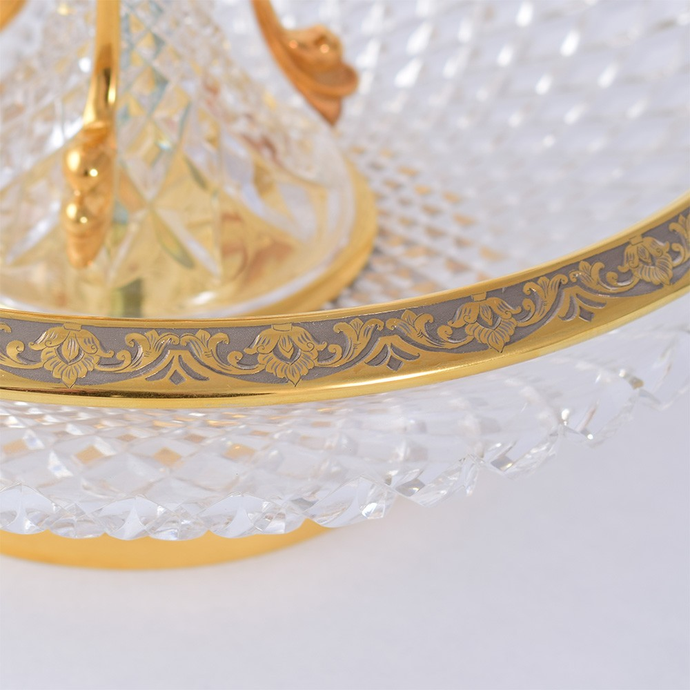 Luxurious crystal vase decorated with gold rings with hand engraving