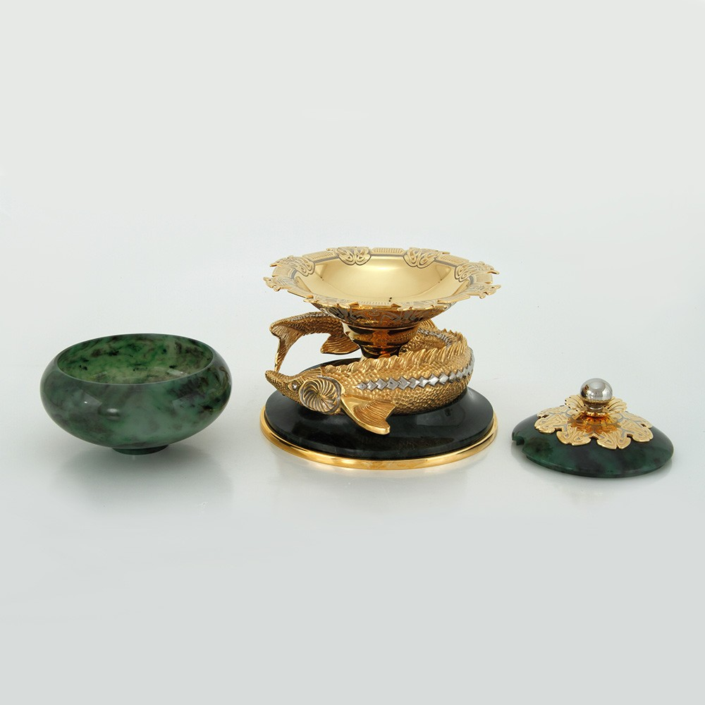 Golden sturgeon encircling a base under a jade bowl