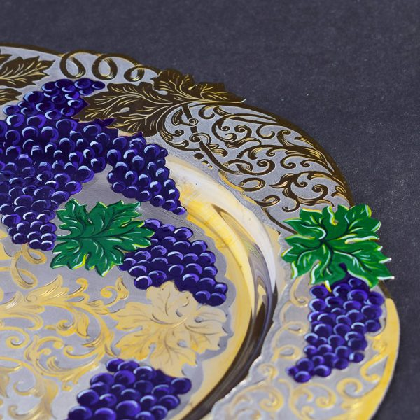 Dish decorated with cutter and enamel