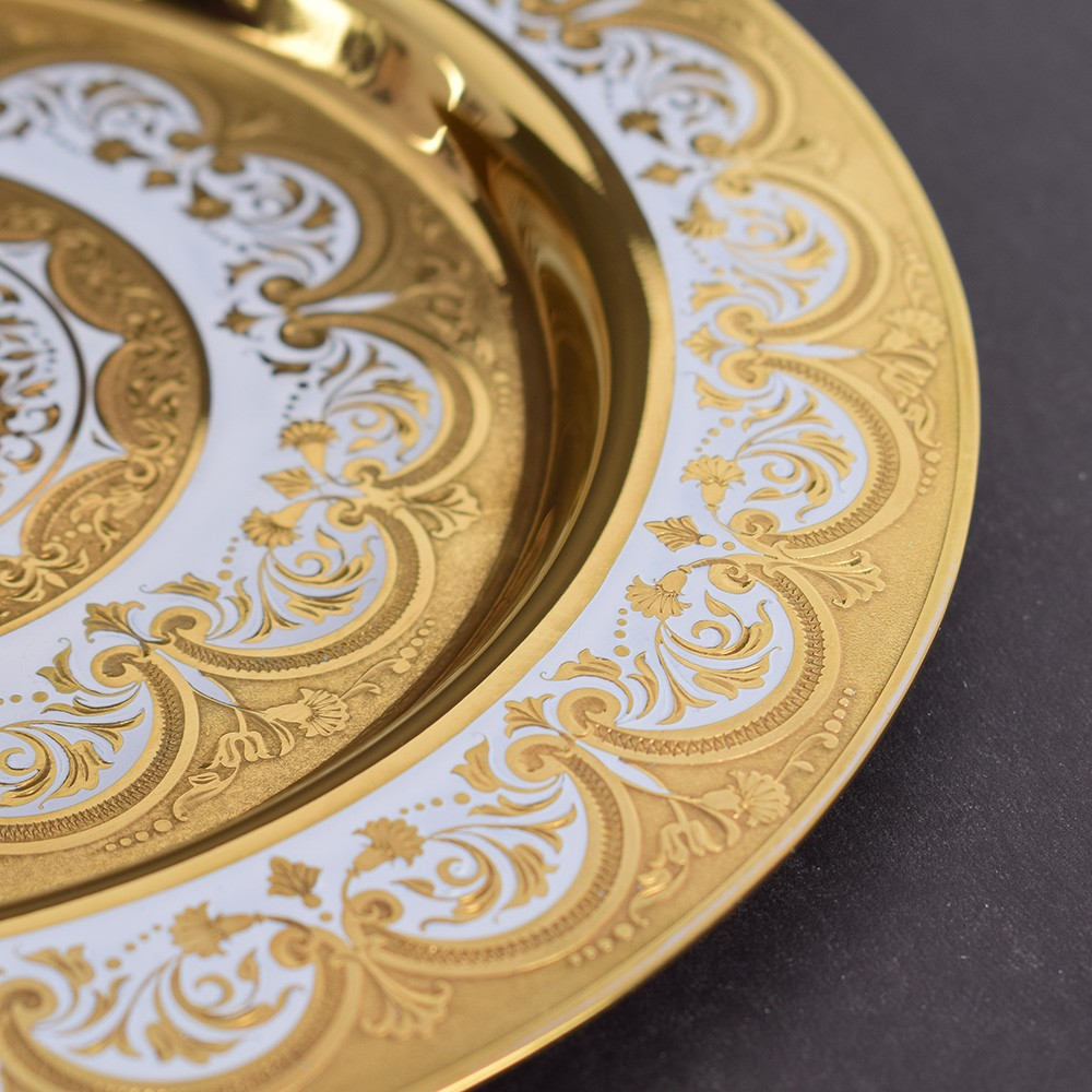 Gold dish painted with a pattern and hand engraved