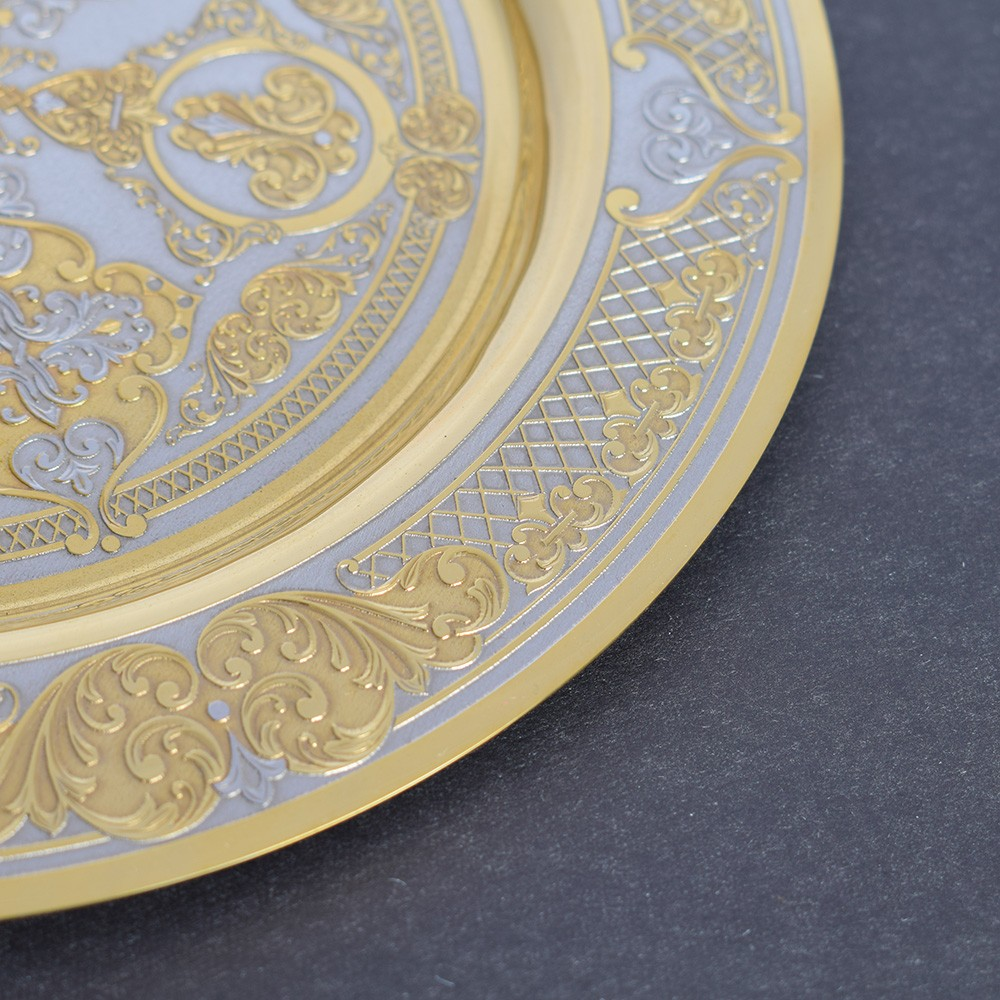 Metal dish specified in the style of Zlatoust engraving