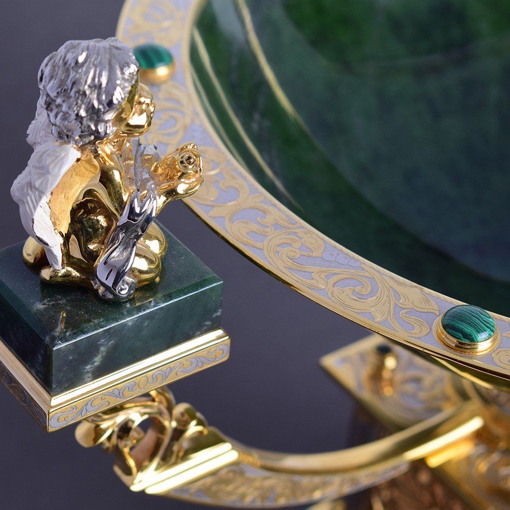 Golden angel on a jade dish