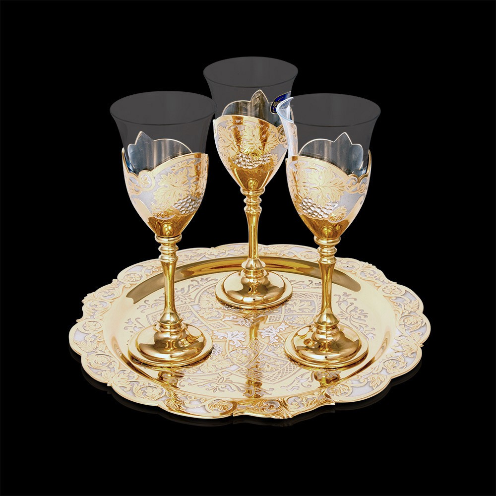Golden tray with three luxurious glasses