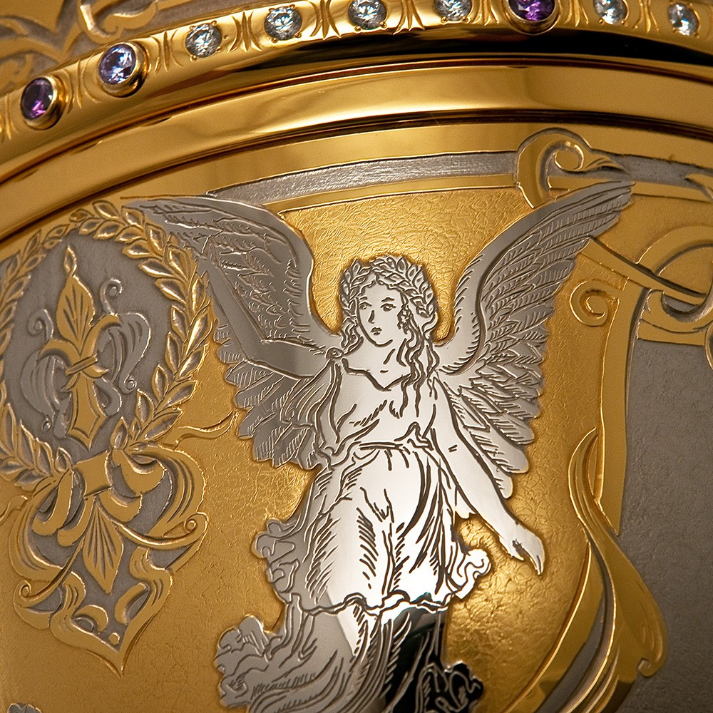 The image of an angel on a cup