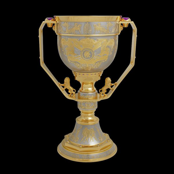 Symbol of a successful deal - gold cup