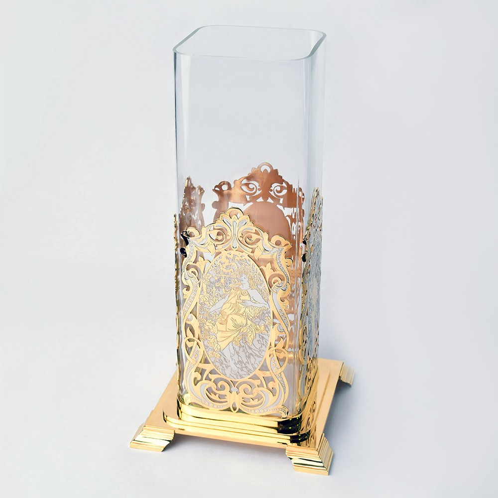 Handmade glass vase in a gold base. Fine jewelry
