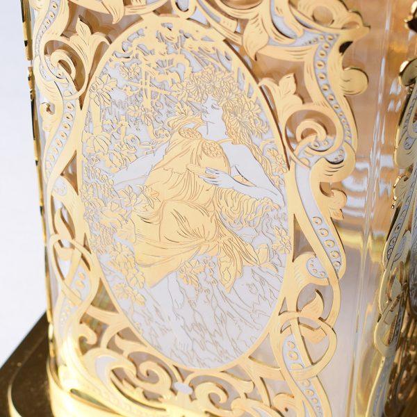 Engraving on the metal of a Greek girl. Handmade designer vase