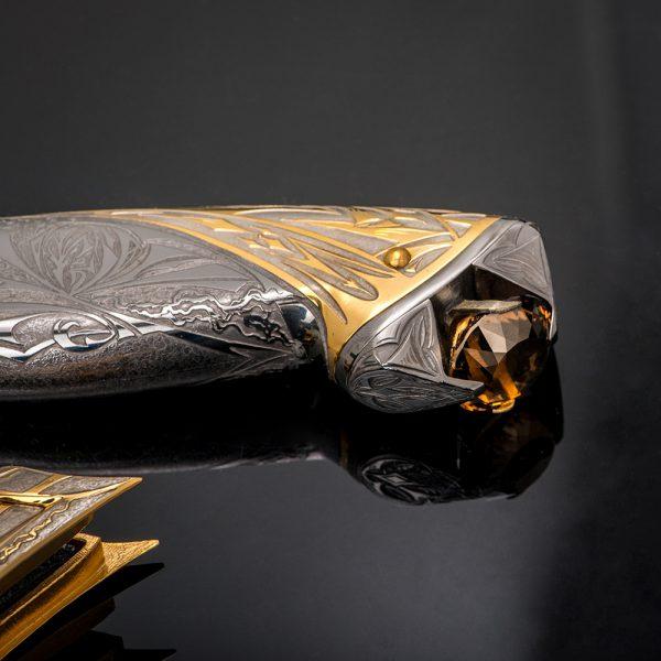 Knife handle with large quartz crystal