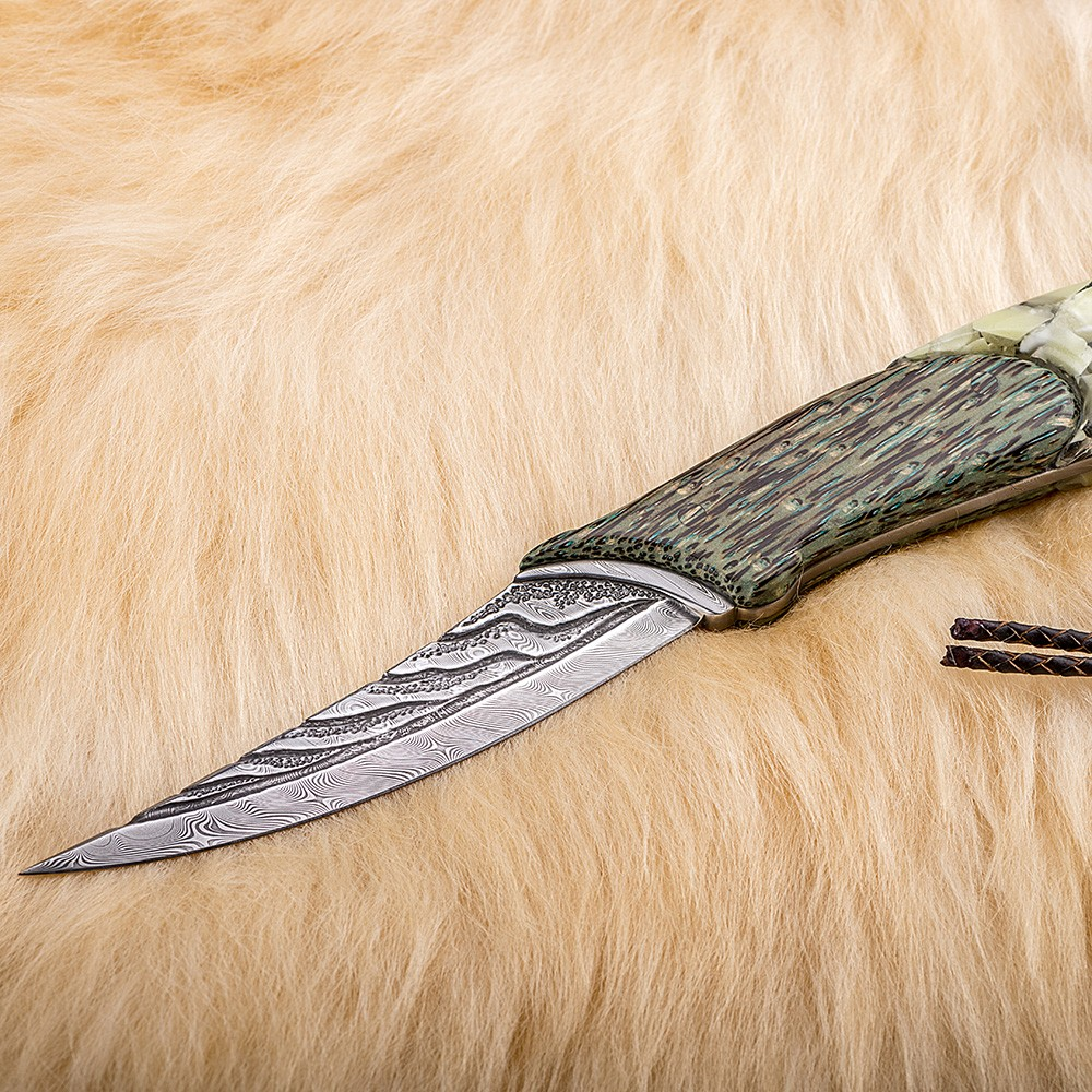 Luxury designer knife from art damascus produced by Vladimir Gerasimov