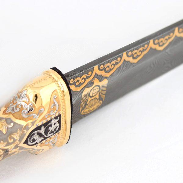 Golden falcon on a damask blade