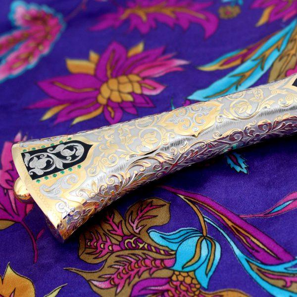 Golden hilt of arab knife