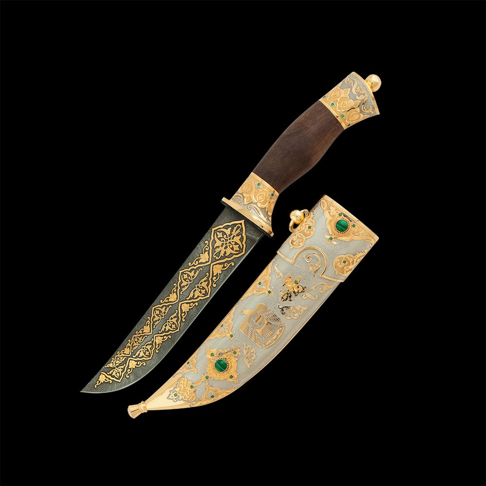Variant of men's gift for the UAE Independence Day. Handmade knife with a gold falcon on a scabbard.