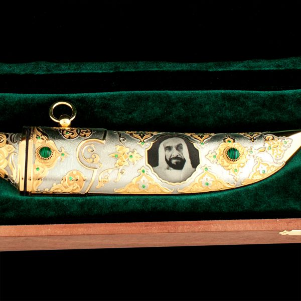 "Luxurious scabbard of a golden knife decorated with the image of ""Father of the UAE nation"""