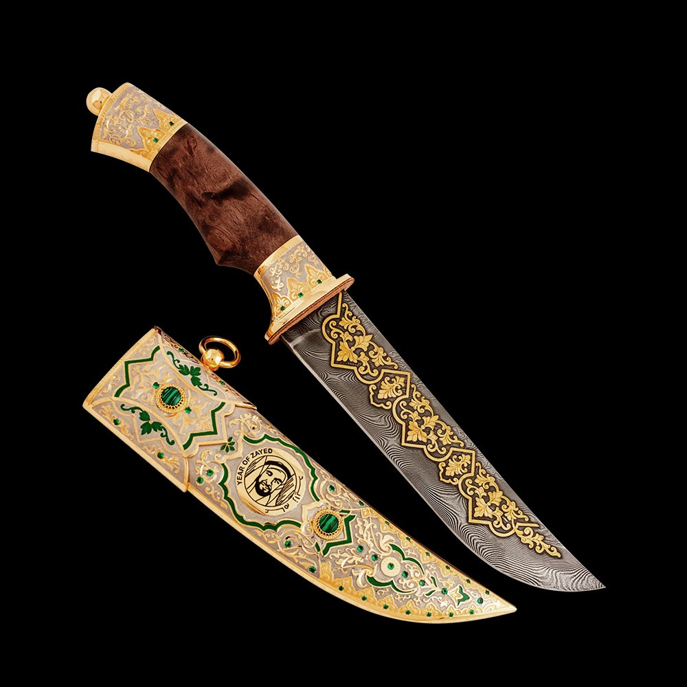 An expensive gift for a man. Handmade knife with the Year of Zayed logo.