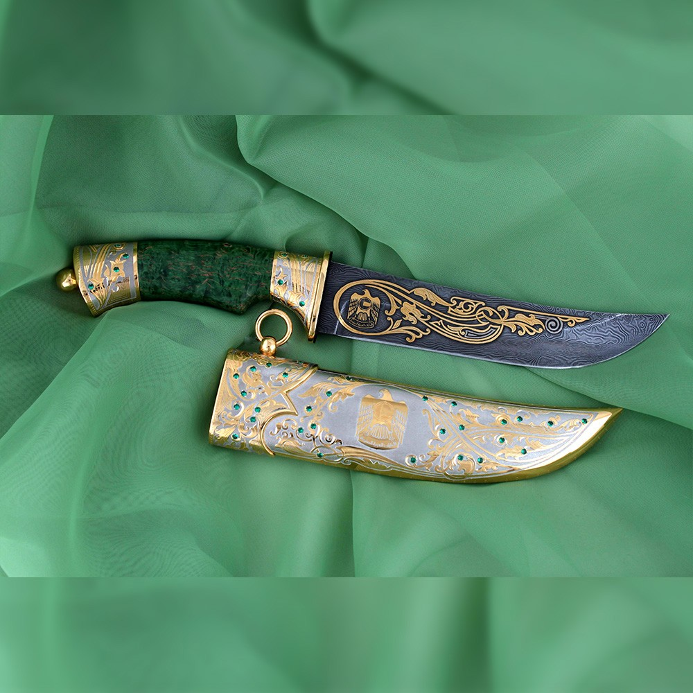 Exclusive handmade knife for the UAE. Green hilt and golden scabbard with falcon
