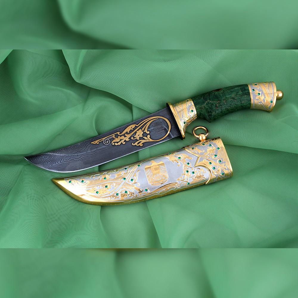 UAE arab knife with a gold falcon on a sheath