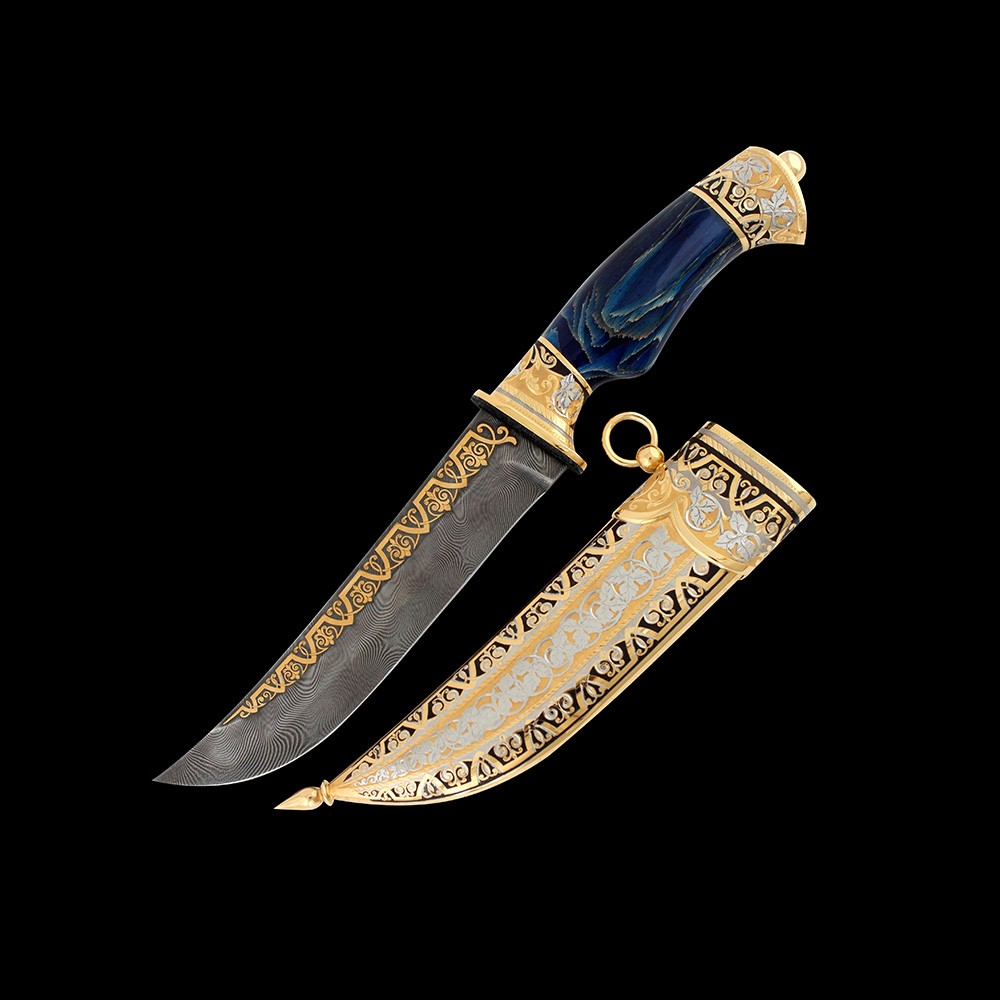 Blue hilt knife with golden scabbard