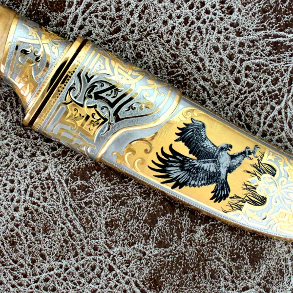 The sheath of the knife is decorated with an art drawing of bird hunting