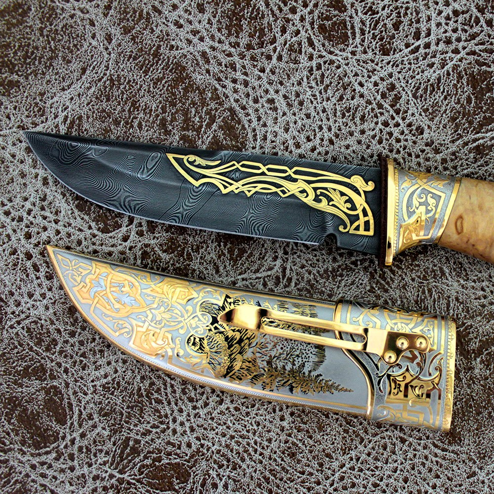 Gold plated knife. Handwork of artists, carvers, gunsmiths