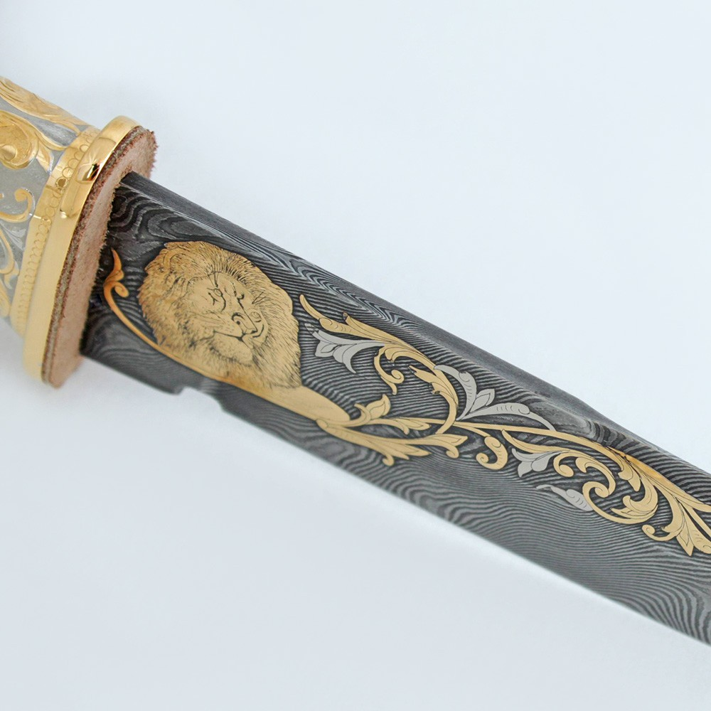 Golden lion on a blade from Damascus