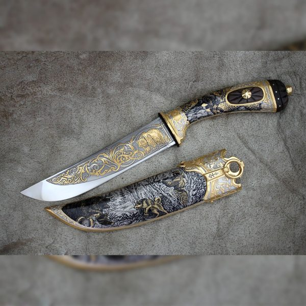 Knife - Bear. The knife is richly decorated with drawings of bear hunting.