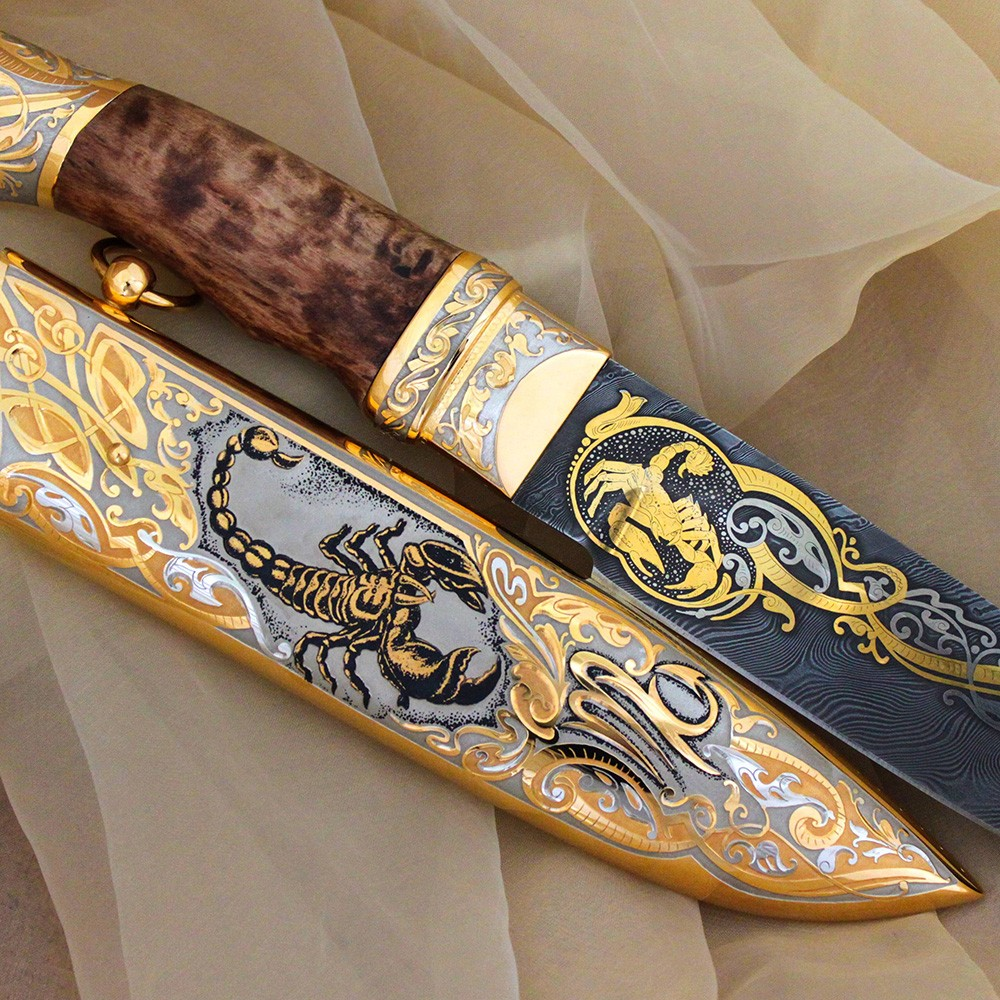 Handmade knife - Scorpio. The damascus steel blade depicts a golden scorpion.