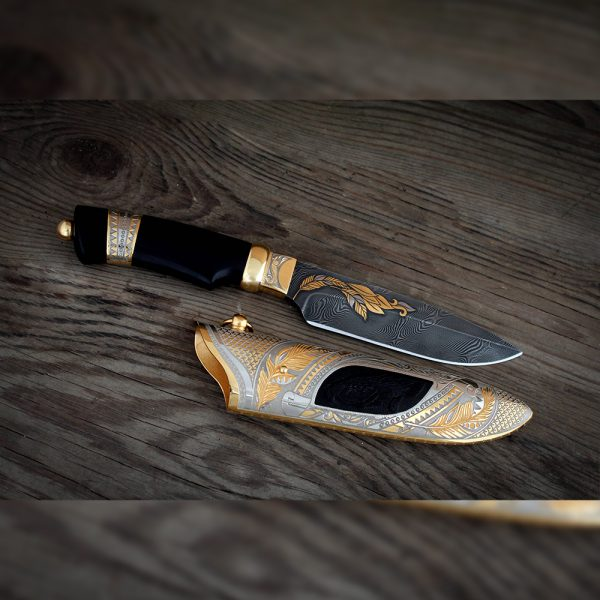 Handmade knife decorated with golden ears of wheat