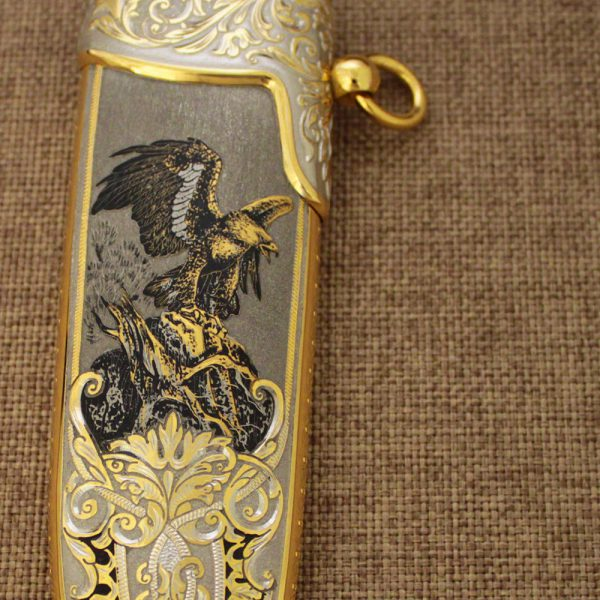 Hand drawing of an eagle on the sheath of a luxury knife