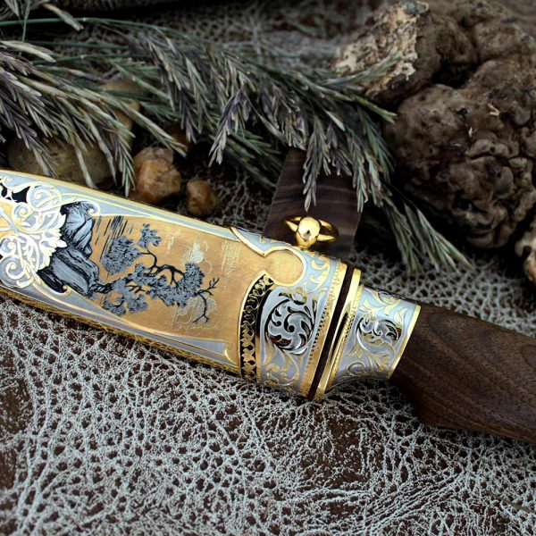 Luxurious handmade knife. Exclusive art engraving of the sheath and knife handle elements