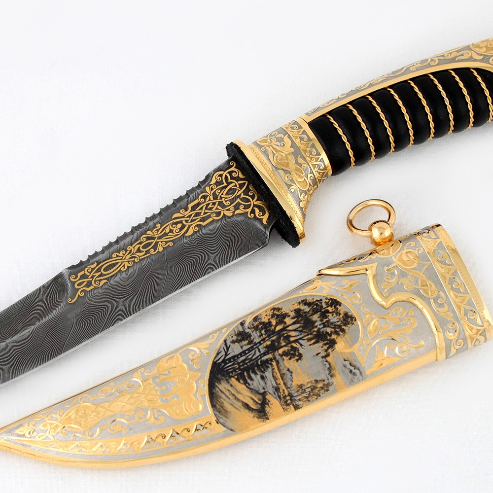 Thin expensive knife with a damascus blade and teeth on the butt. The hilt and scabbard are covered with gold and embossed patterns. The leather handle comfortably lay in the hand and does not slip out when wet.