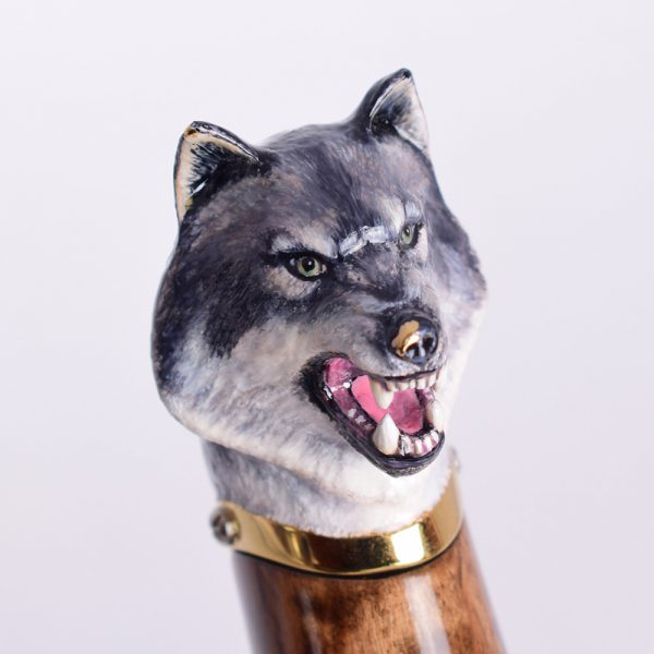 Art decoration of a hilt of a knife with a wolf's head