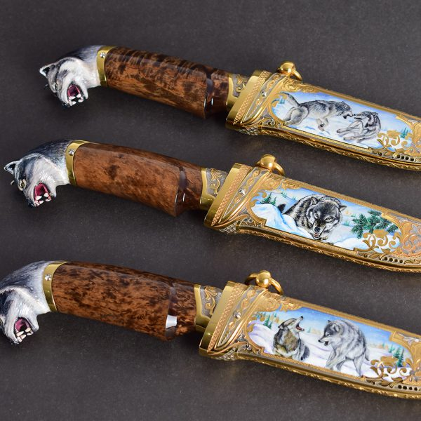 Three handmade knives with a wolf hilt