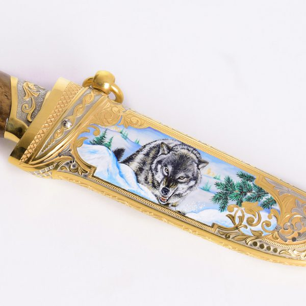Weapon Artwork - Artistic drawing of a wolf on a golden knife sheath