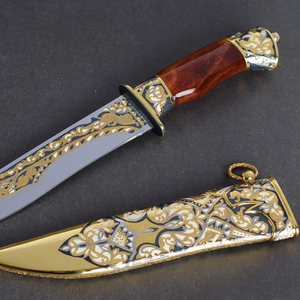 Luxurious knife richly decorated in a sophisticated technique of metal carving, artistic enameling and multi-chased gilding