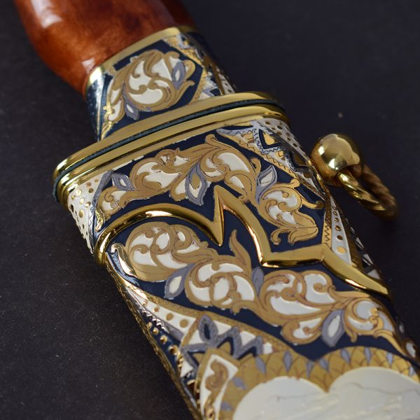 The all-metal sheath of the knife coated with a complex pattern. Handwork of Russian masters.
