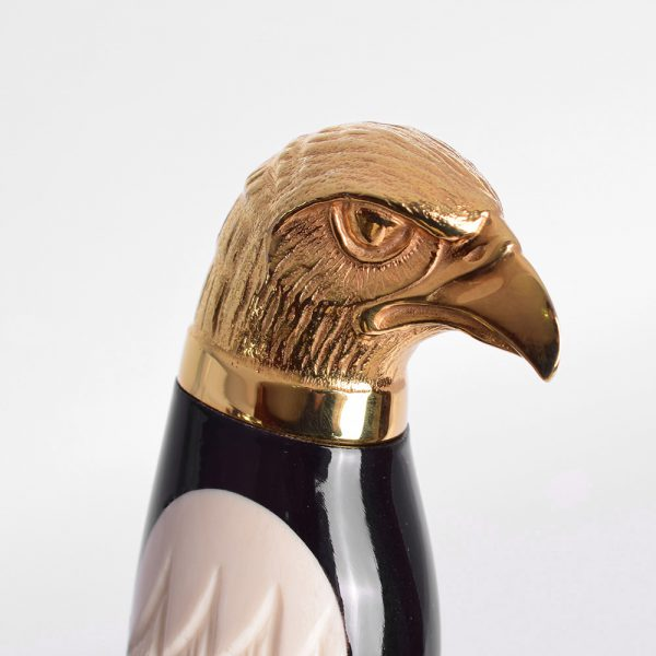 The handle of a knife with the head of a golden eagle.