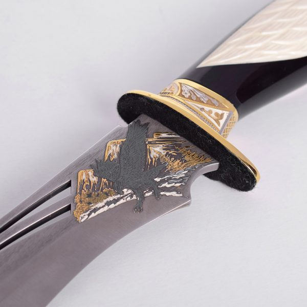 Perforated knife blade with an eagle pattern. Exclusive knife decor