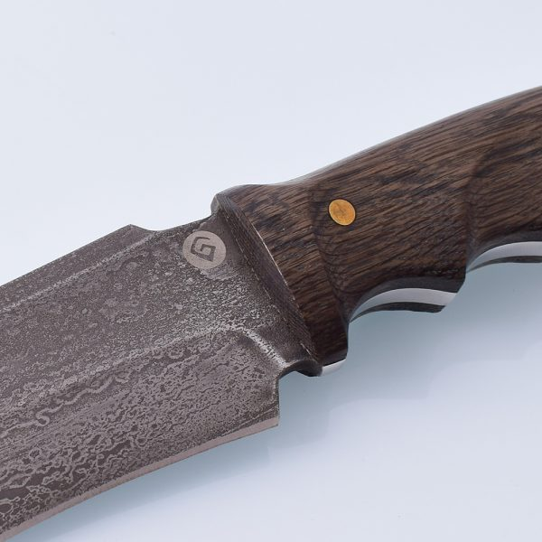 Knife handle made of wood on rivets