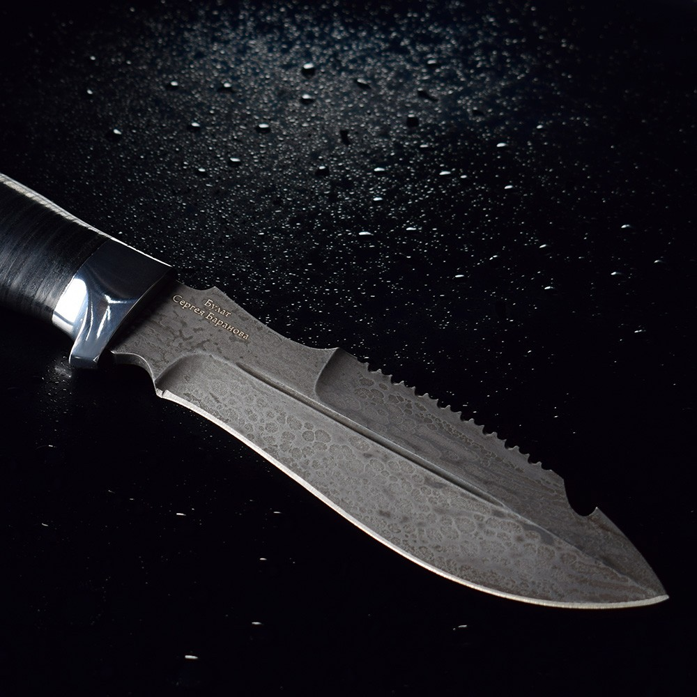 Large blade of a knife on drops of water