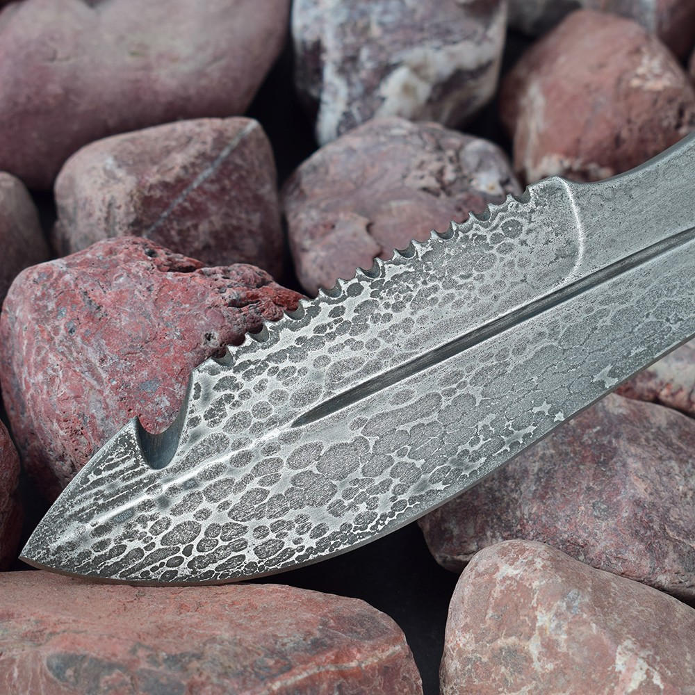 Mysterious metal blade of graphite color with an amazing pattern.
