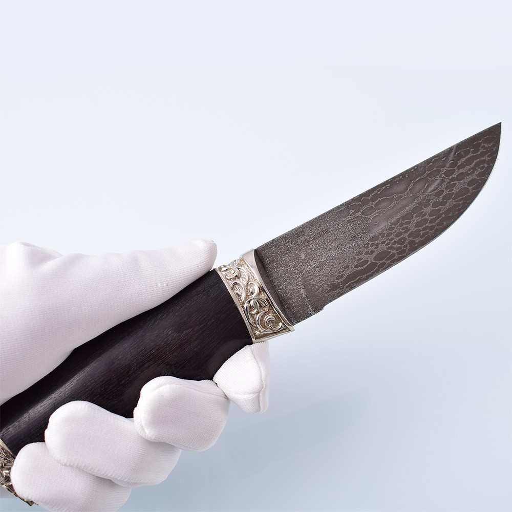 This stylish author's knife is made of the legendary stainless cast bulat steel, cupronickel, as well as from a hard stabilized hornbeam. Knife lovers will appreciate the ergonomic properties of this knife. The knife was made by Sergei Baranov from bulat steel he discovered.