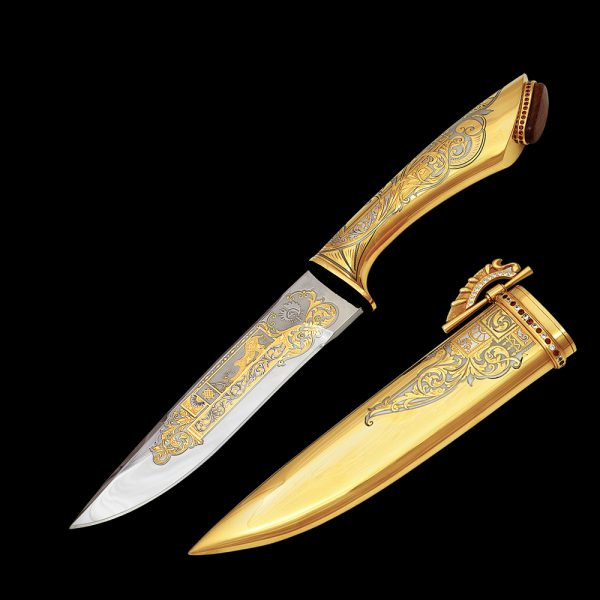 Golden knife with a mirror blade decorated with drawings