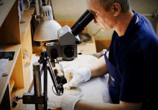 Engraving a picture under a microscope. Zlatoust master